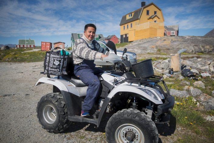 Minik from Nanortalik on his ATV with freshly caight arctic charr and other stuff in Nanortalik in South Greenland. Photo by Mads Pihl.
