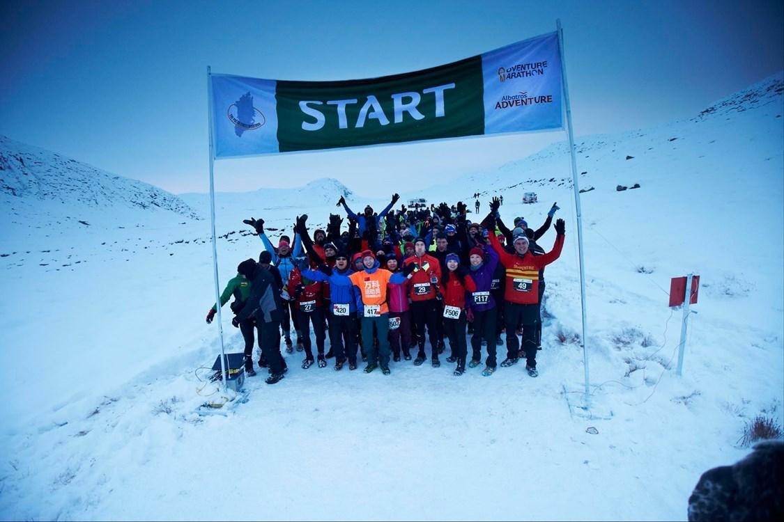 Polar Circle Marathon Participants ready for start. Happy man and woman posing at the polar circle marathon. By Visit Greenland