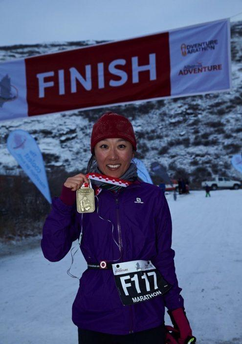Participant showing off medal. By Visit Greenland