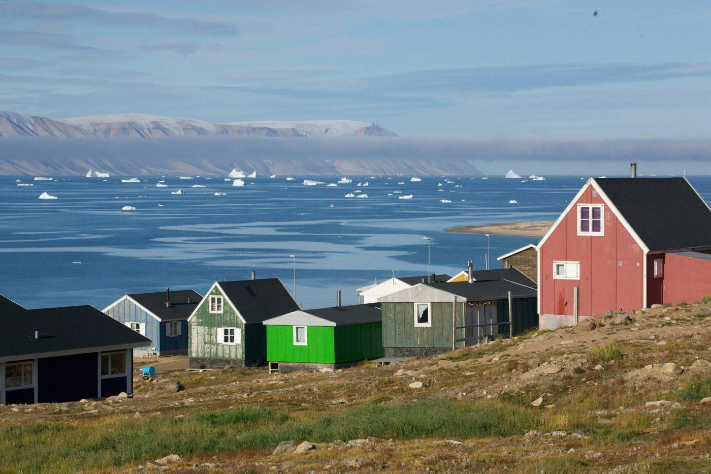 Qaanaaq, with view over the sea towards Herbert Island. Photo by Glenn Mattsing.
