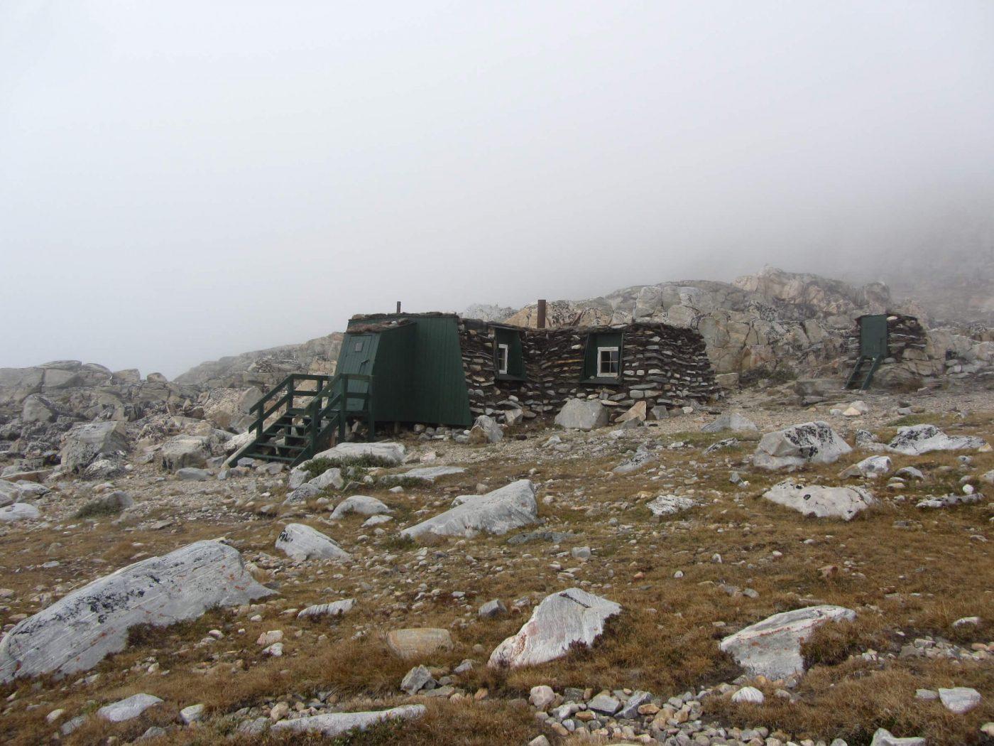 Inuit turf hut reconstruction on a foggy day outside Uummannaq in North Greenland, by Ella Grødem.