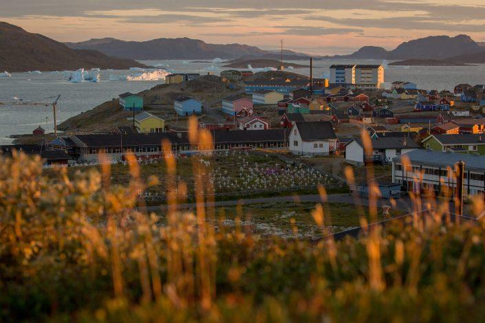 Sunset over Narsaq and the bay with icebergs in South Greenland. Photo by Mads Pihl.