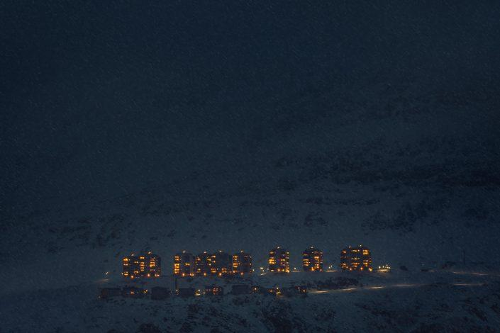 The Suloraq towers seen through a snow shower in Nuuk in Greenland. By Mads Pihl