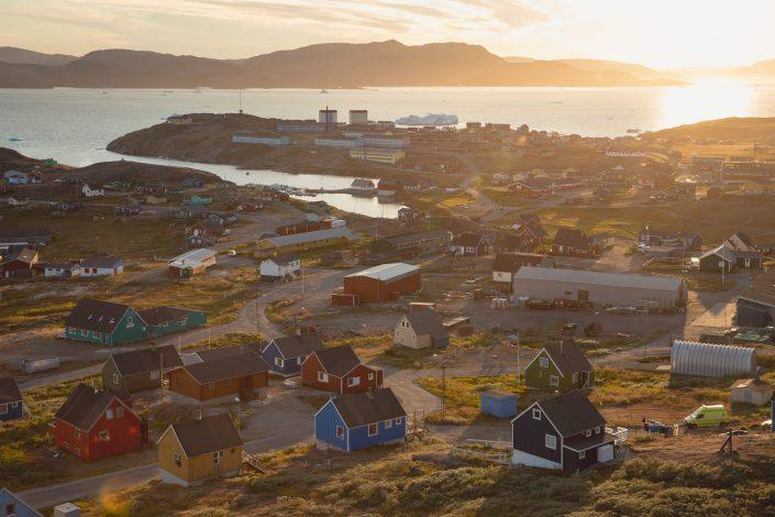 The sun sets over Narsaq in South Greenland. .Photo by Mads Pihl