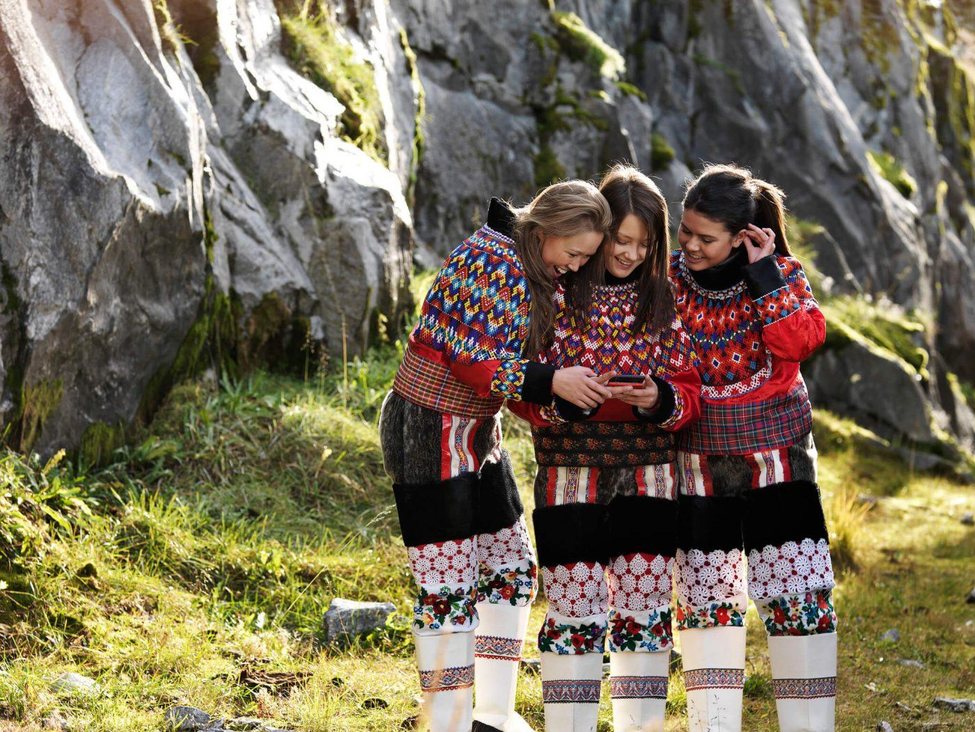 Three girls in greenlandic traditional clothes. By David Trood