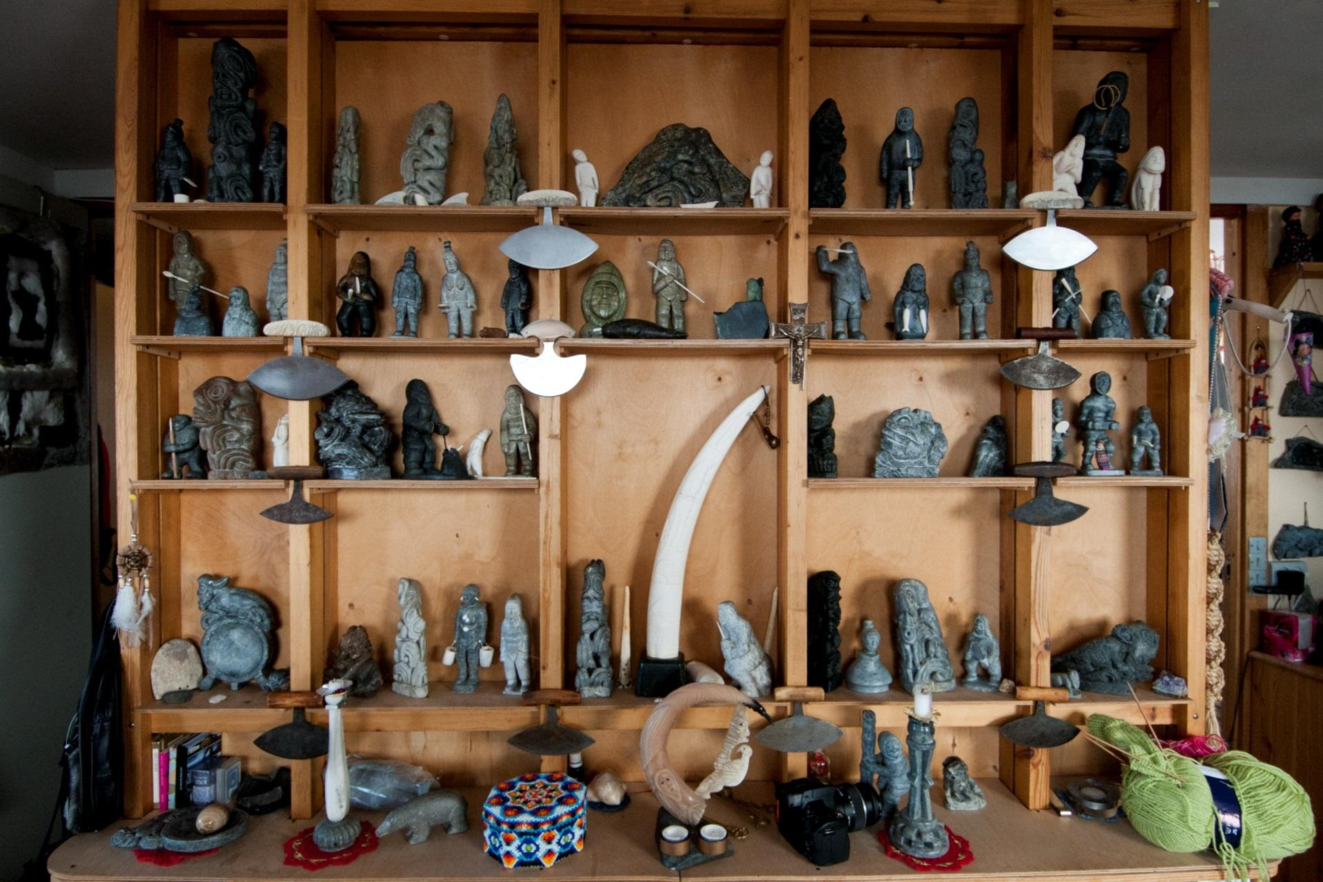 Shelf with Soapstone Art. By Mads Pihl