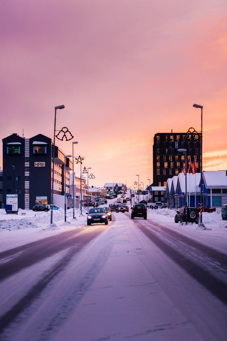 Traffic on the main road in Nuuk, Greenland on a beautiful winter sunset afternoon. Photo by Rebecca Gustafsson