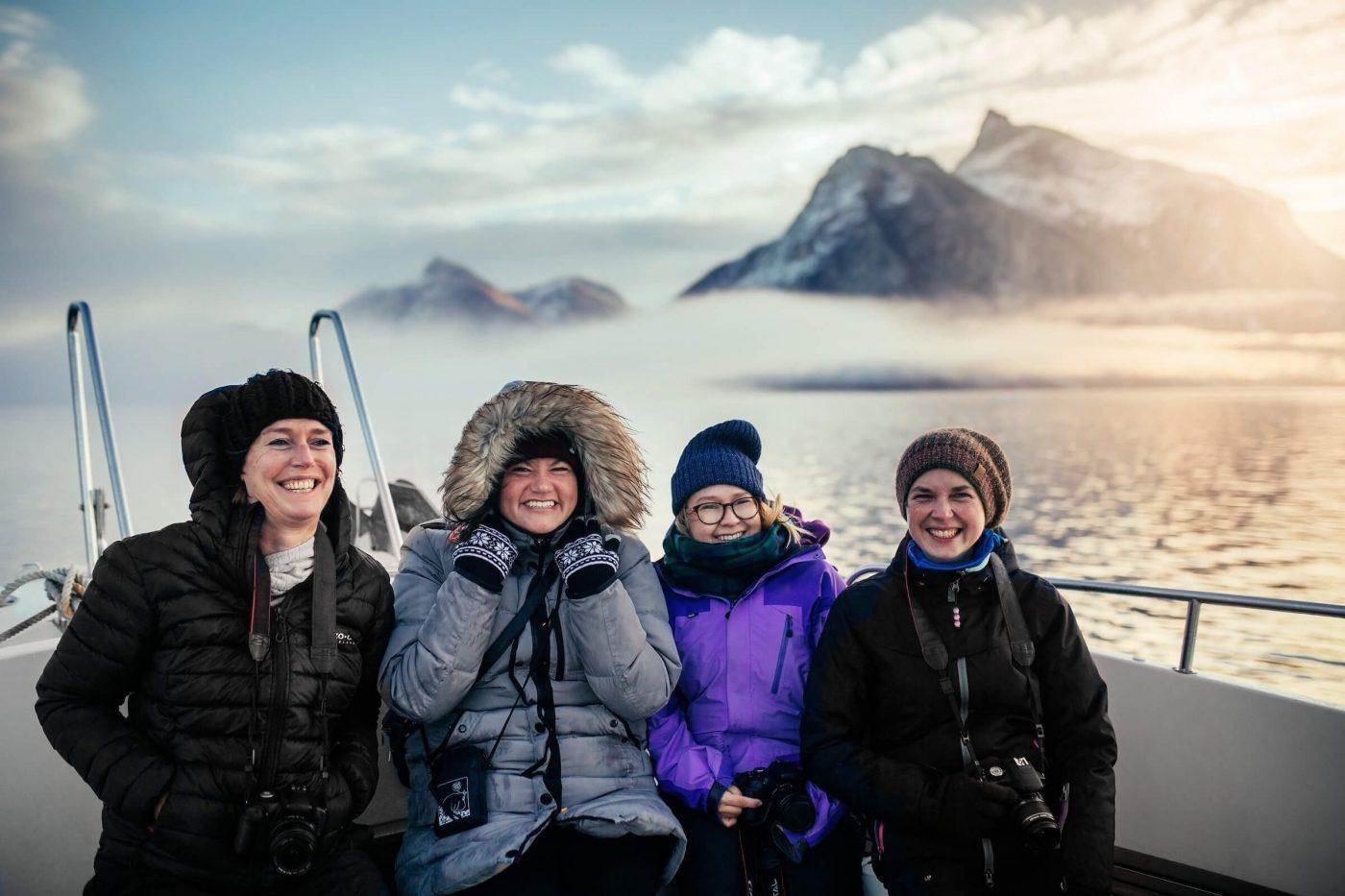 Group photo of tourists on a boat in the Icefjord in Nuuk in Greenland. Photo by Rebecca Gustafsson.