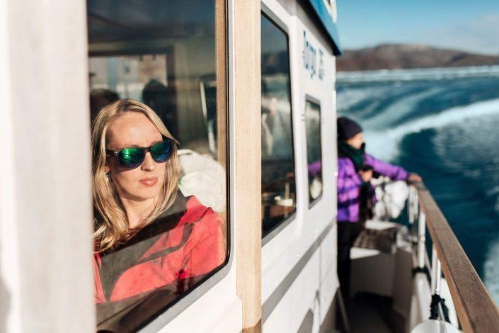 Woman looking at the view from inside a boat in the Icefjord in Nuuk in Greenland. Photo by Rebecca Gustafsson.