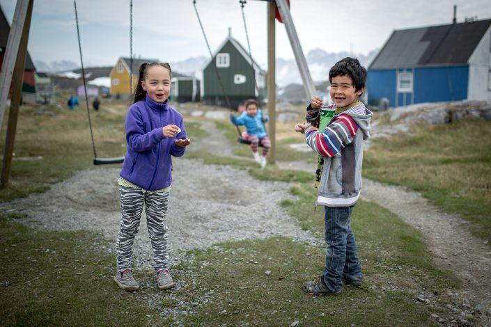Two kids at the playground in Itilleq in Greenland. Photo by Mads Pihl