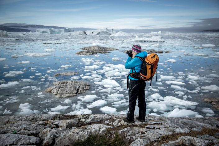Photographer takes a picture of an icy fjord in Greenland. Photo by Mads Pihl