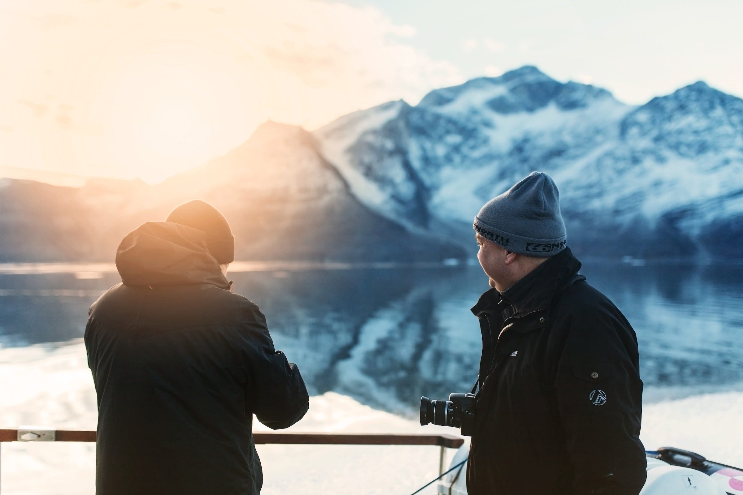 Two men enjoying the sunrise in the Icefjord in Nuuk in Greenland. Photo by Rebecca Gustafsson, Visit Greenland.