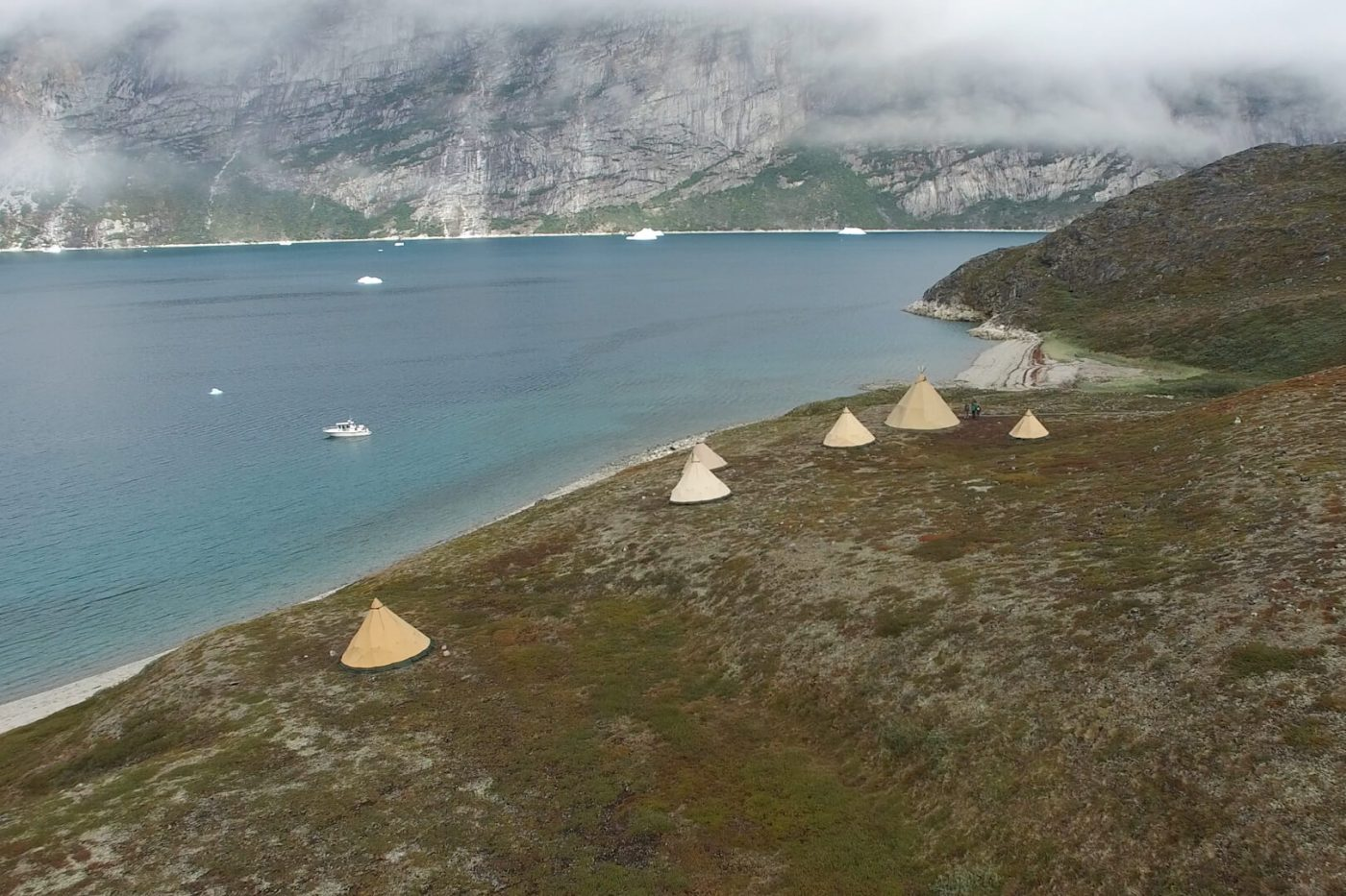 Camp at the waterfront viewed from above. Photo by Arctic Nomad