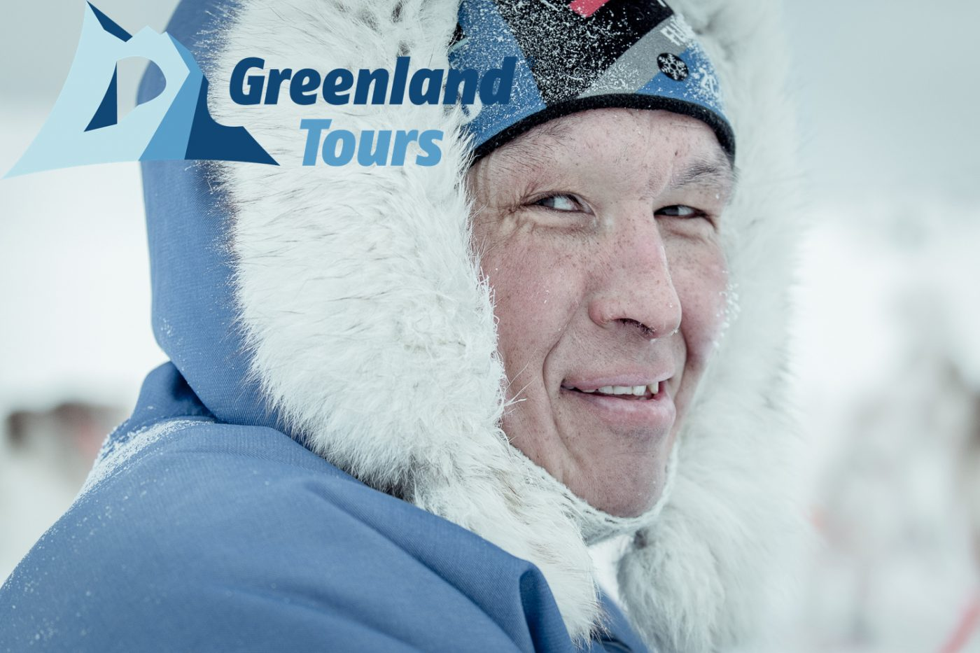 Portrait of a dog musher on his sled near Oqaatsut in Greenland_Greenland Tours_Hearts ofthe Inuit