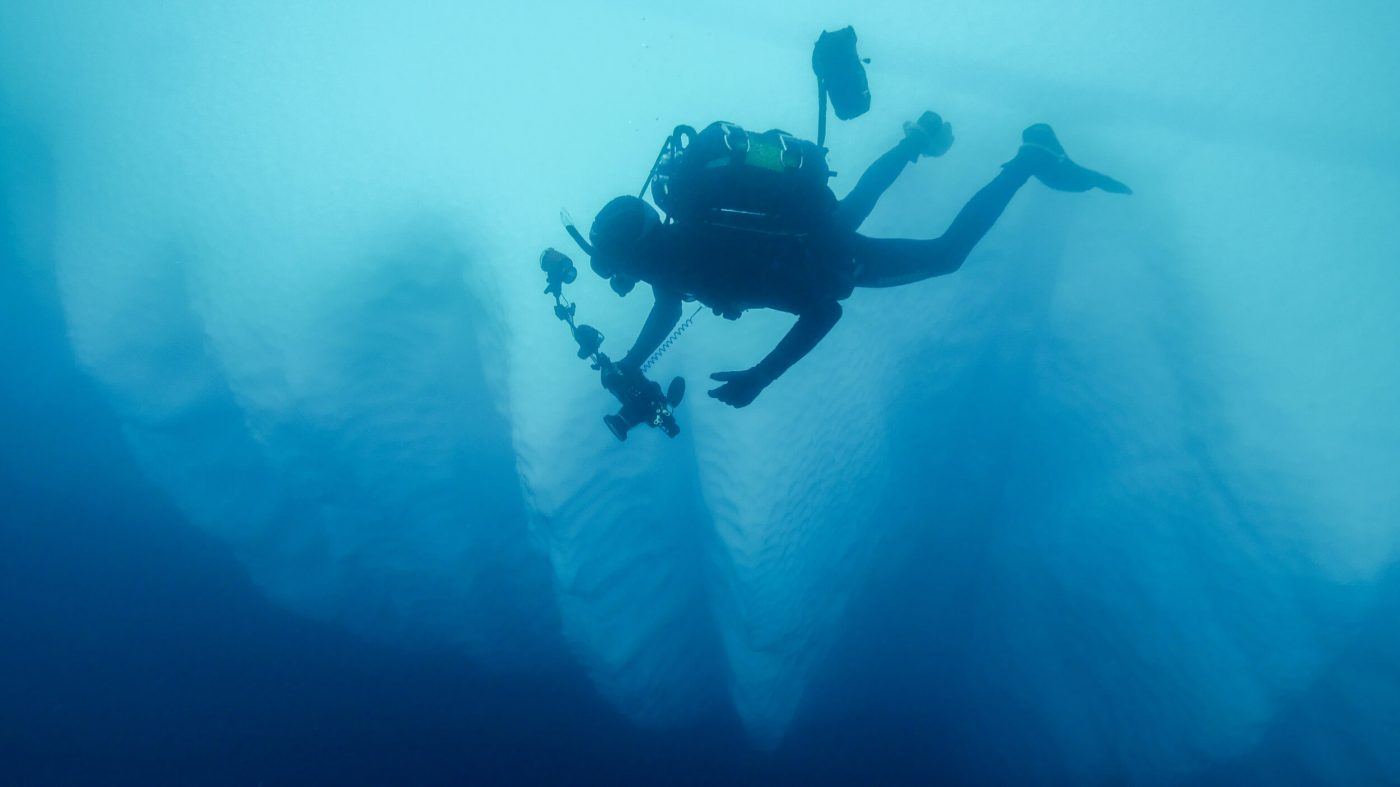 Kingsley Griffin descends next to a giant iceberg