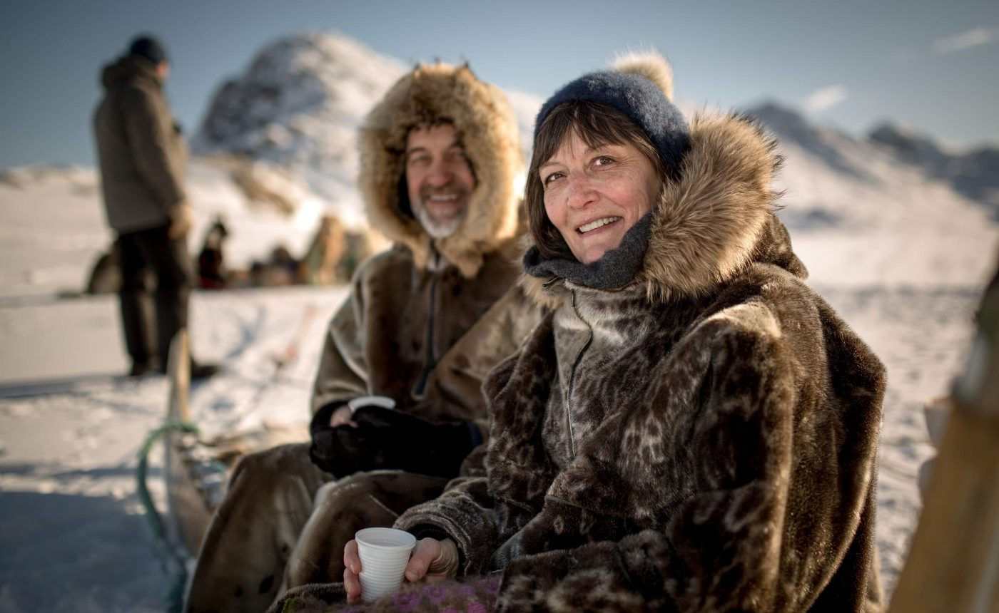 Happy couple takes break from dog sled in Sisimiut. Photo by Mads Pihl