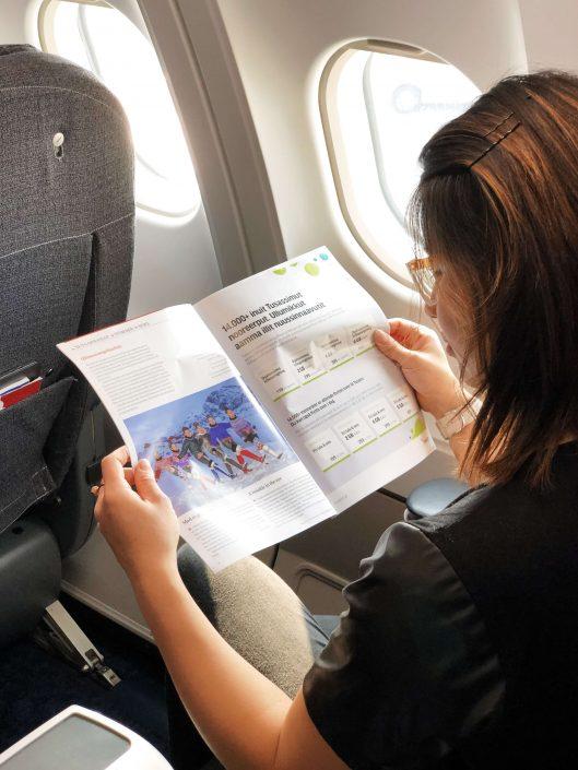 Passenger reading the safety manual at an Air Greenland flight