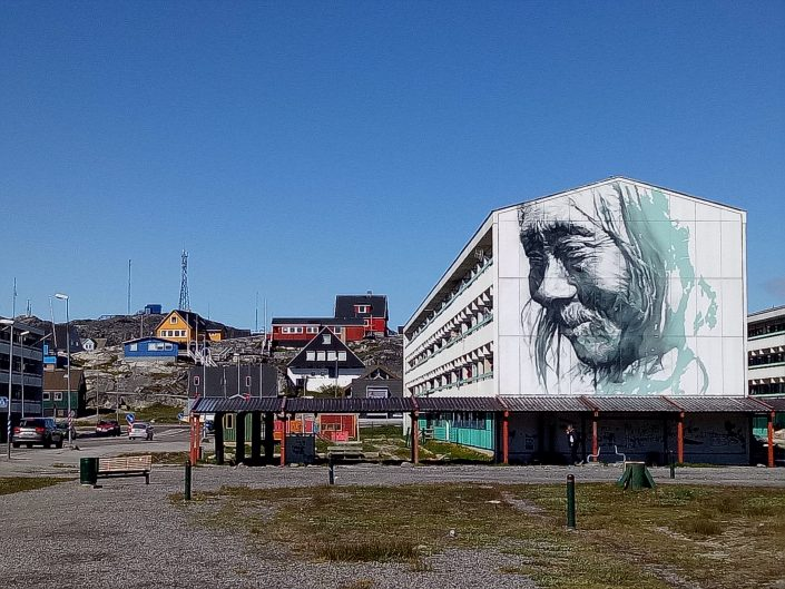 The center of Nuuk and the large-scale street art by the artist Guido van Helten from Australia. Photo by Leslie Carter