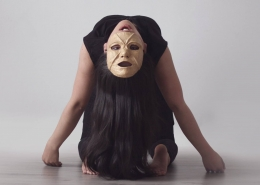Girl in mask in the play Inuit from Nunatta Isiginnaartitsisarfia. Photo by The National Theatre of Greenland - Visit Greenland
