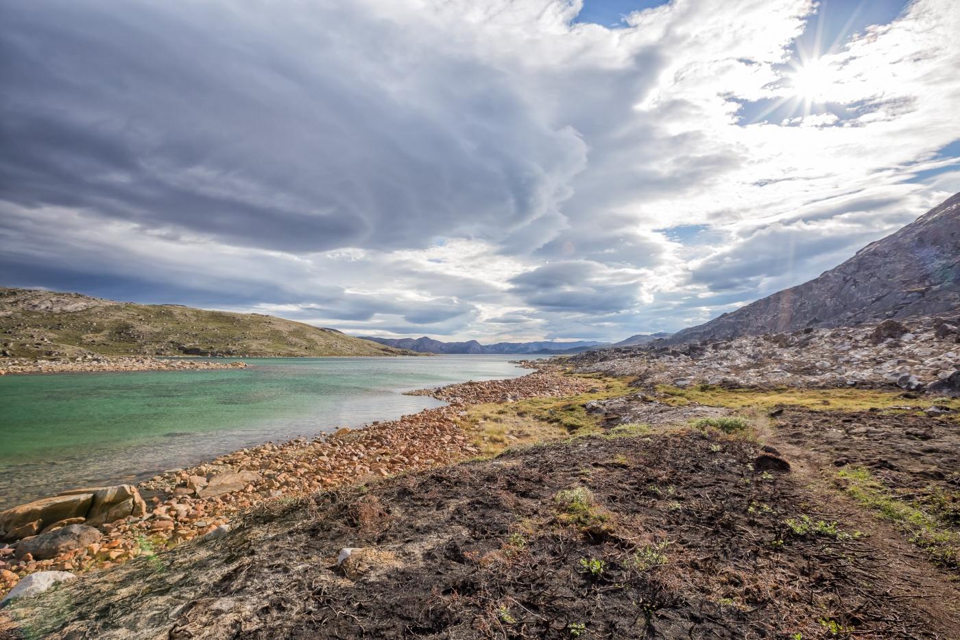 Rough shoreline along Amitsorsuaq Lake on the Arctic Circle Trail. Photo by Lina Stock.