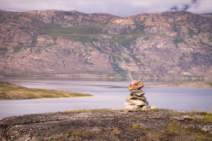 Stone Cairn with characteristic red dot topped with a reindeer skull - Day 3 of Arctic Circle Trail. Photo by Lisa Germany.