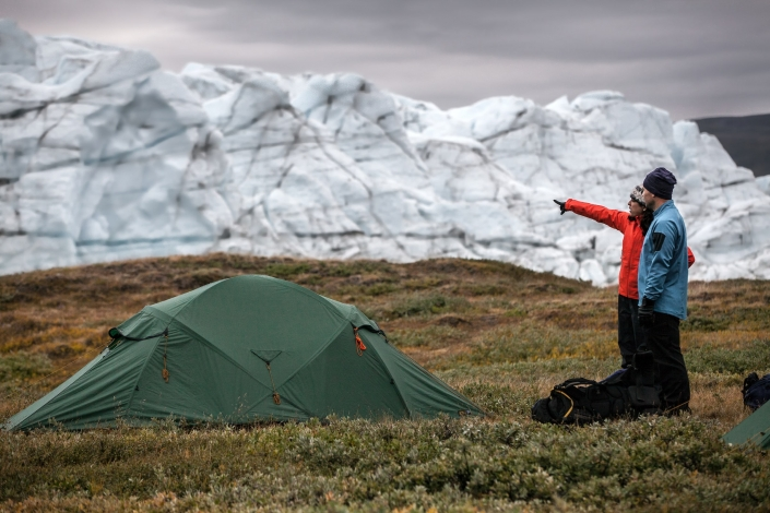 Two hikers at a tent camp by Russell Glacier near Kangerlussuaq in Greenland. Photo by Mads Pihl - Visit Greenland.