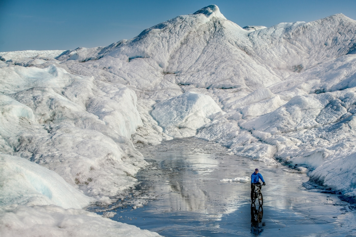A mountain biker on the Greenland Ice Sheet near Kangerlussuaq. Photo by Mads Pihl - Visit Greenland