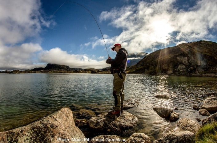 A fisherman at the shores of a lake near the river Erfalik in Greenland. Photo by Mads Pihl – Visit Greenland
