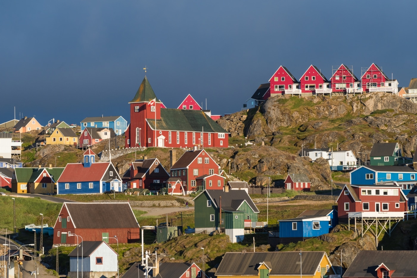 Sisimiut town and its colourful buildings in sun. Photo by West Greenland Wildlife – Visit Greenland