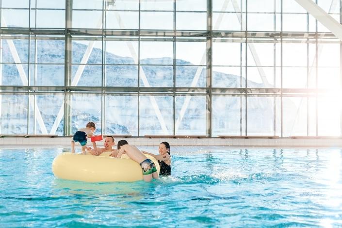 Family having fun in the indoor swimming pool Malik in Nuuk in Greenland.Photo by by Rebecca Gustafsson - Visit Greenland