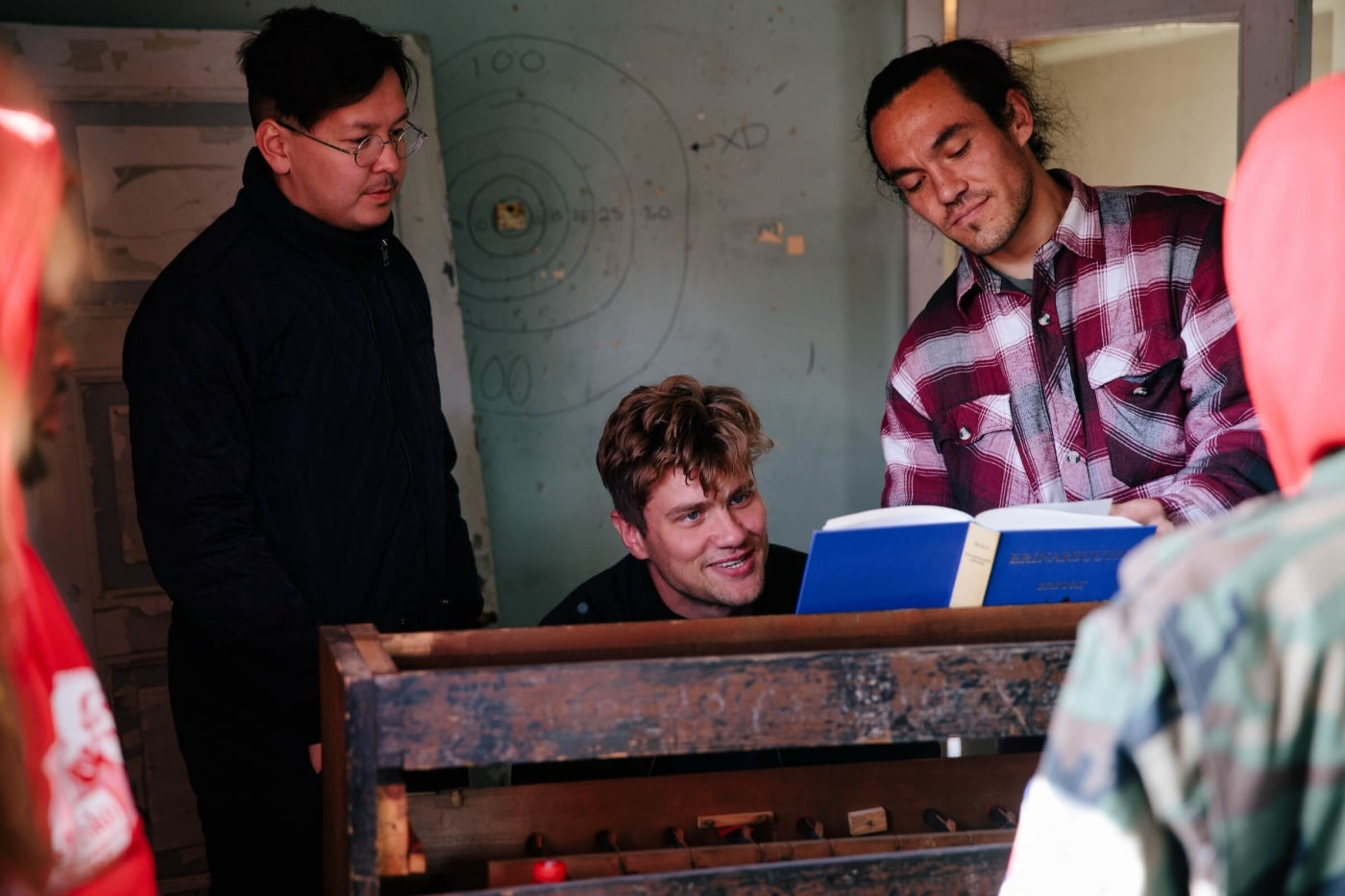 Hans-Henrik Suersaq Poulsen together with Bjarni Frímann and Miké Thomsen in the Post House. Photo by Jessie Brinkman Evans - Visit Greenland