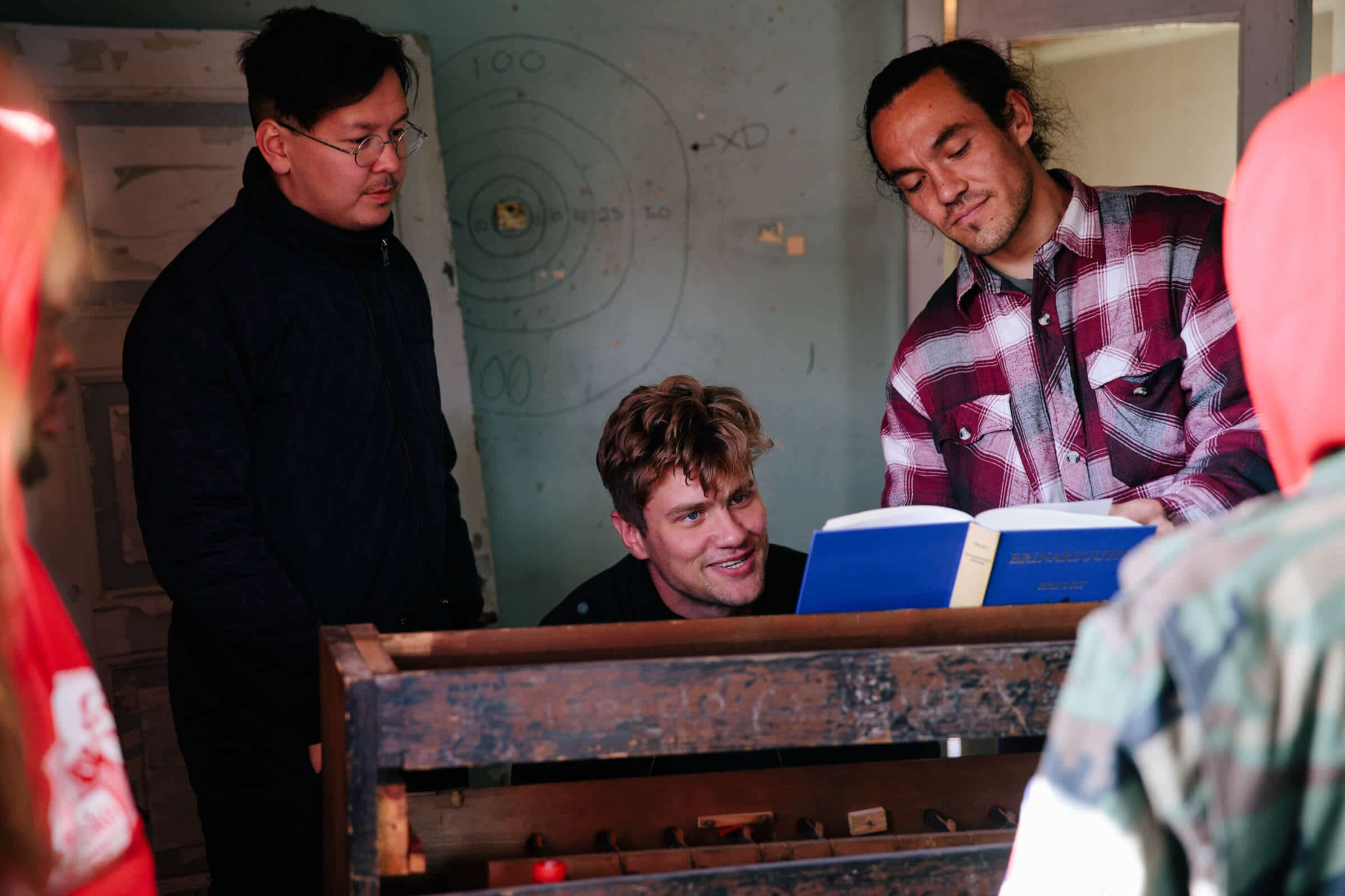 Hans-Henrik Suersaq Poulsen together with Bjarni Frímann and Miké Thomsen in the Post House. Photo by Jessie Brinkman Evans - Visit Greenland