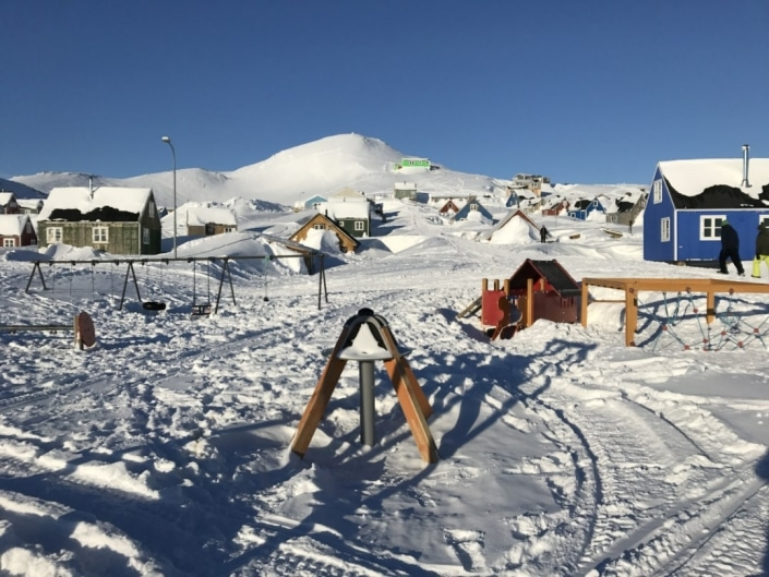 Playground in Ittoqqortoormiit covered in snow. Photo by Syazwani Baumgartner