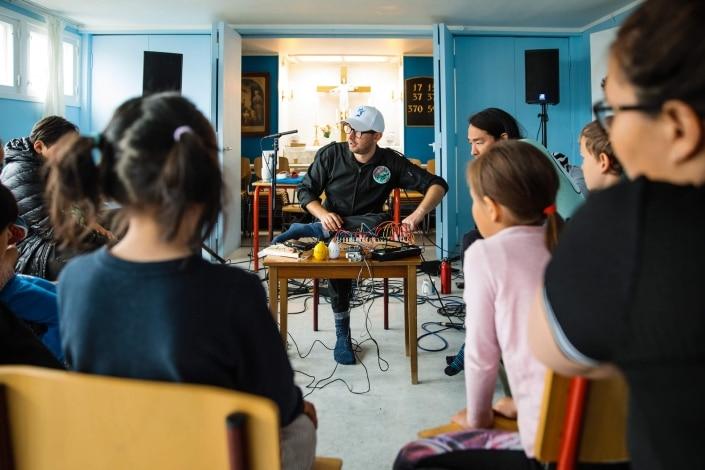 Woutr von Jaspers during a show in the church_school. Photo by Jessie Brinkman Evans - Visit Greenland