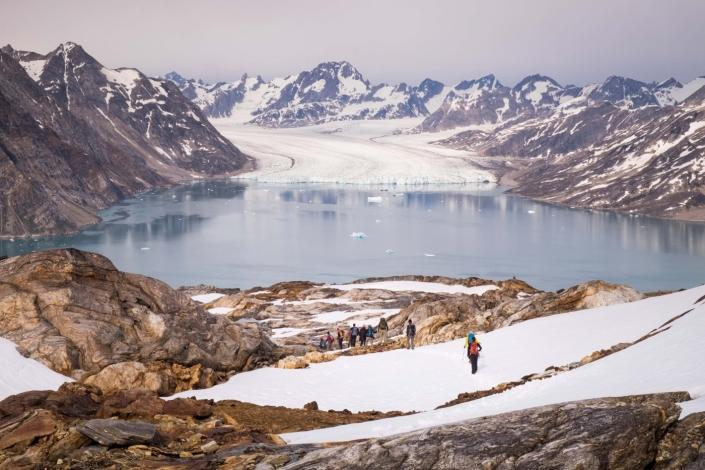 East Tasiilaq summer knud-rasmussen glacier from mountain view with hikers. Photo by Guide to Greenland, Visit Greenland