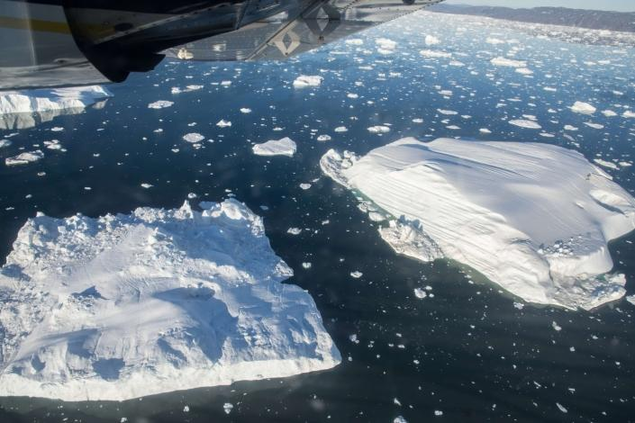 View from flight looking down at icebergs in the arctic ocean. Photo by Guide to Greenland, Visit Greenland