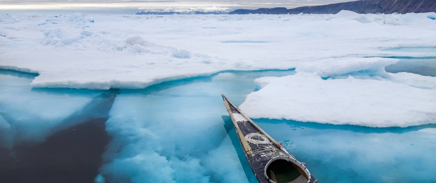 Empty kayak waiting by the pack ice. Photo by Kim Insuk - Visit Greenland