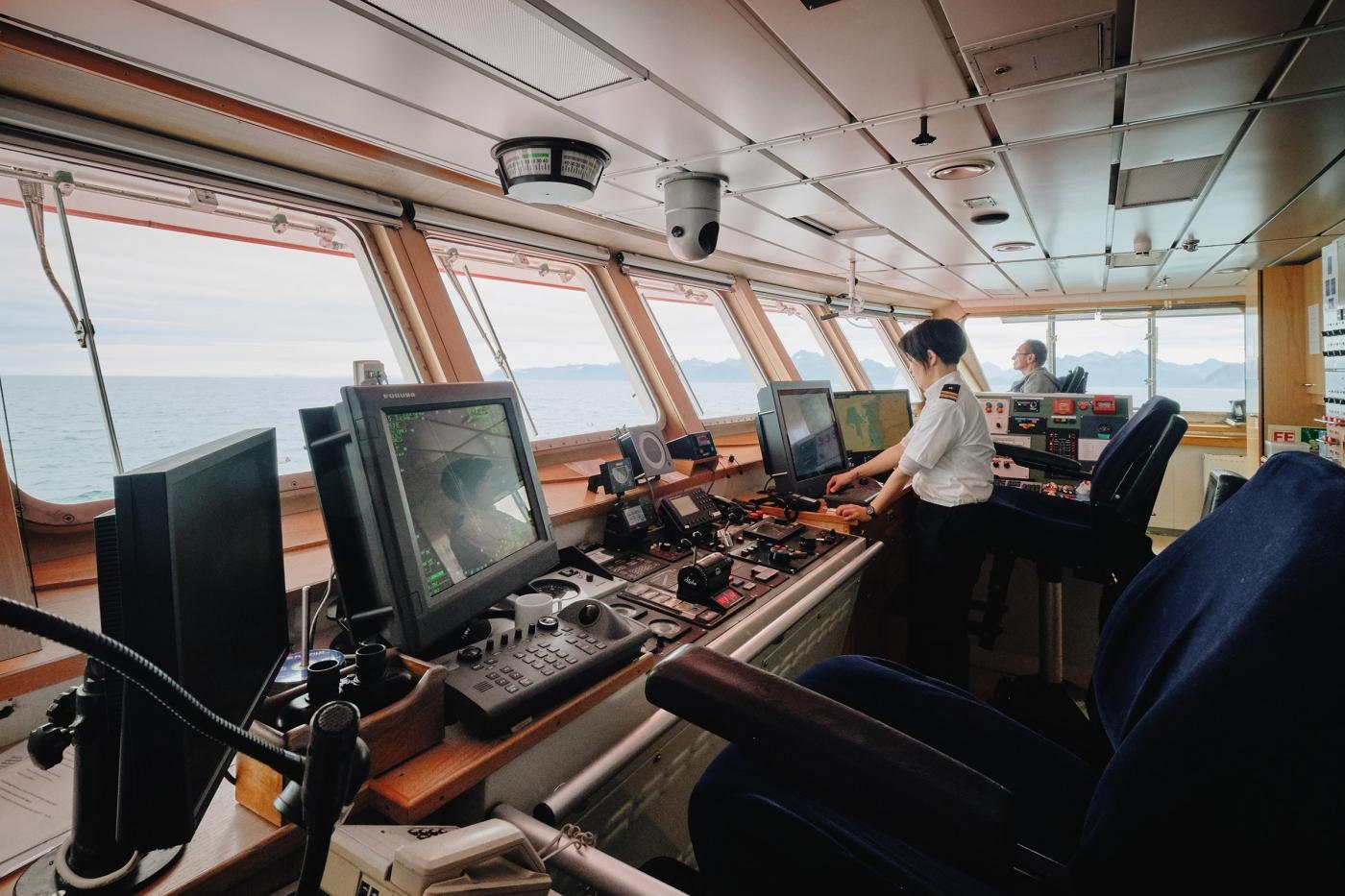 Second Officer at the helm on Sarfaq Ittuk Bridge. Photo by Lisa Germany