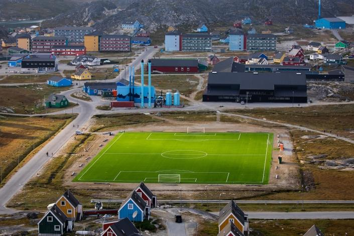 View to the soccer field of Paamiut. Photo by Aningaaq R Carlsen - Visit Greenland