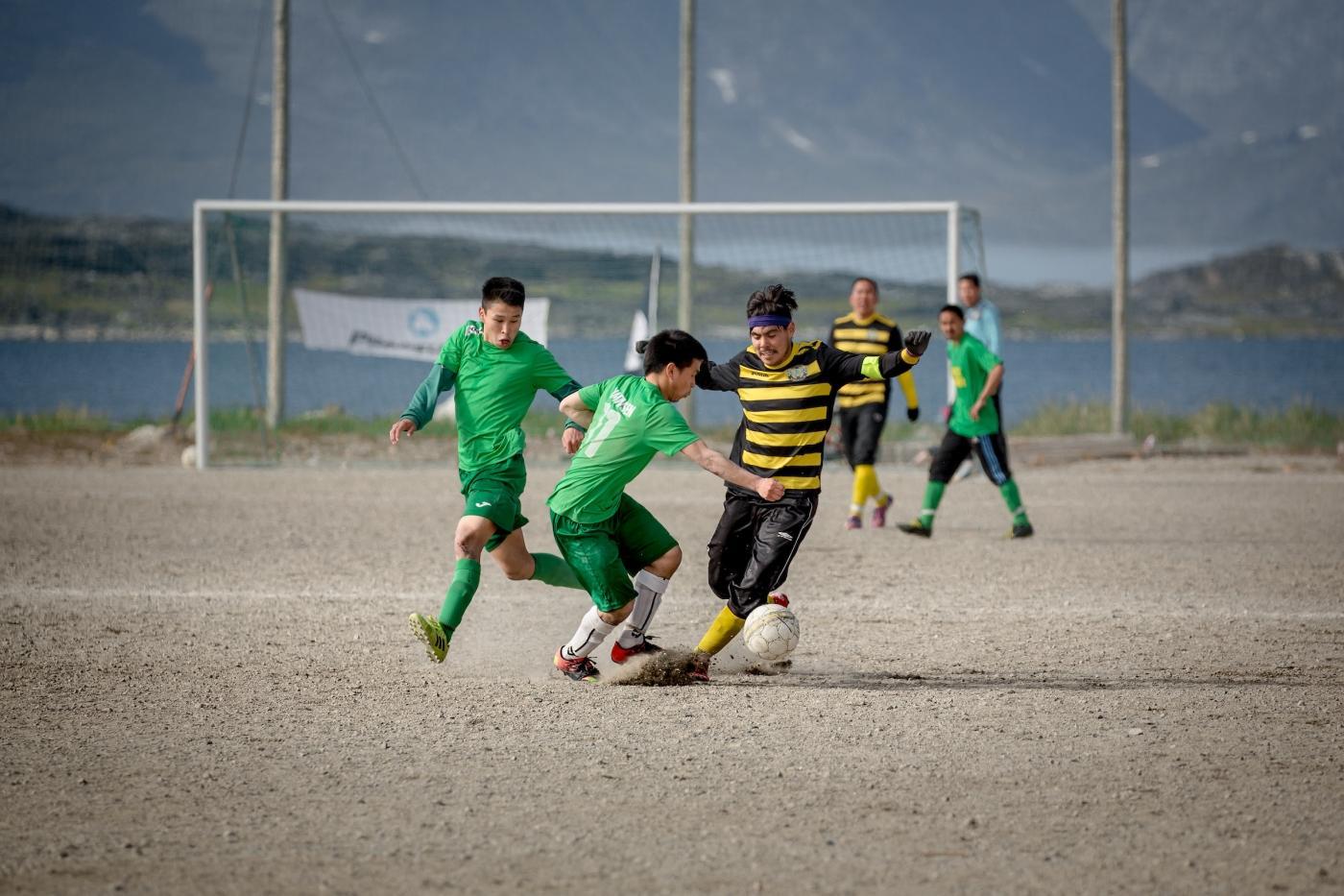 Soccer players from Nanortalik and Narsarmiit at the local Nanortalik championships in South Greenland. Photo by Mads Pihl - Visit Greenland