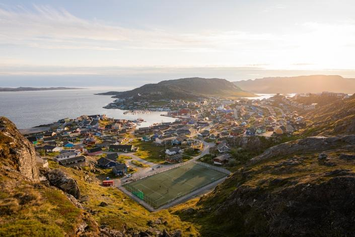 The evening sun shines towards the Qaqortoq town in the summer. Photo by Aningaaq R Carlsen - Visit Greenland