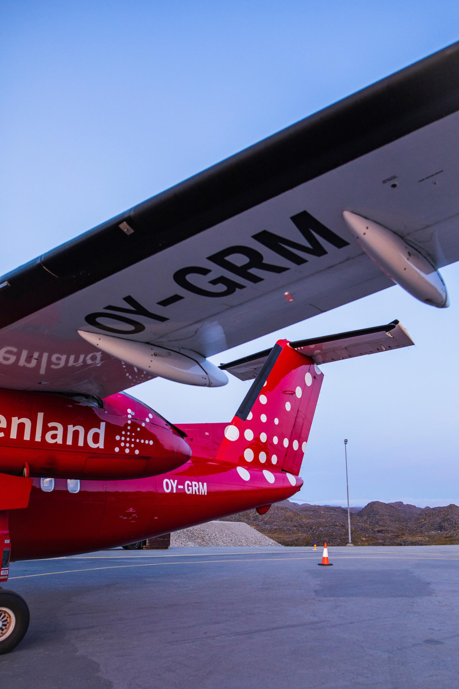 Airplane wing. Photo by Aningaaq R Carlsen - Visit Greenland