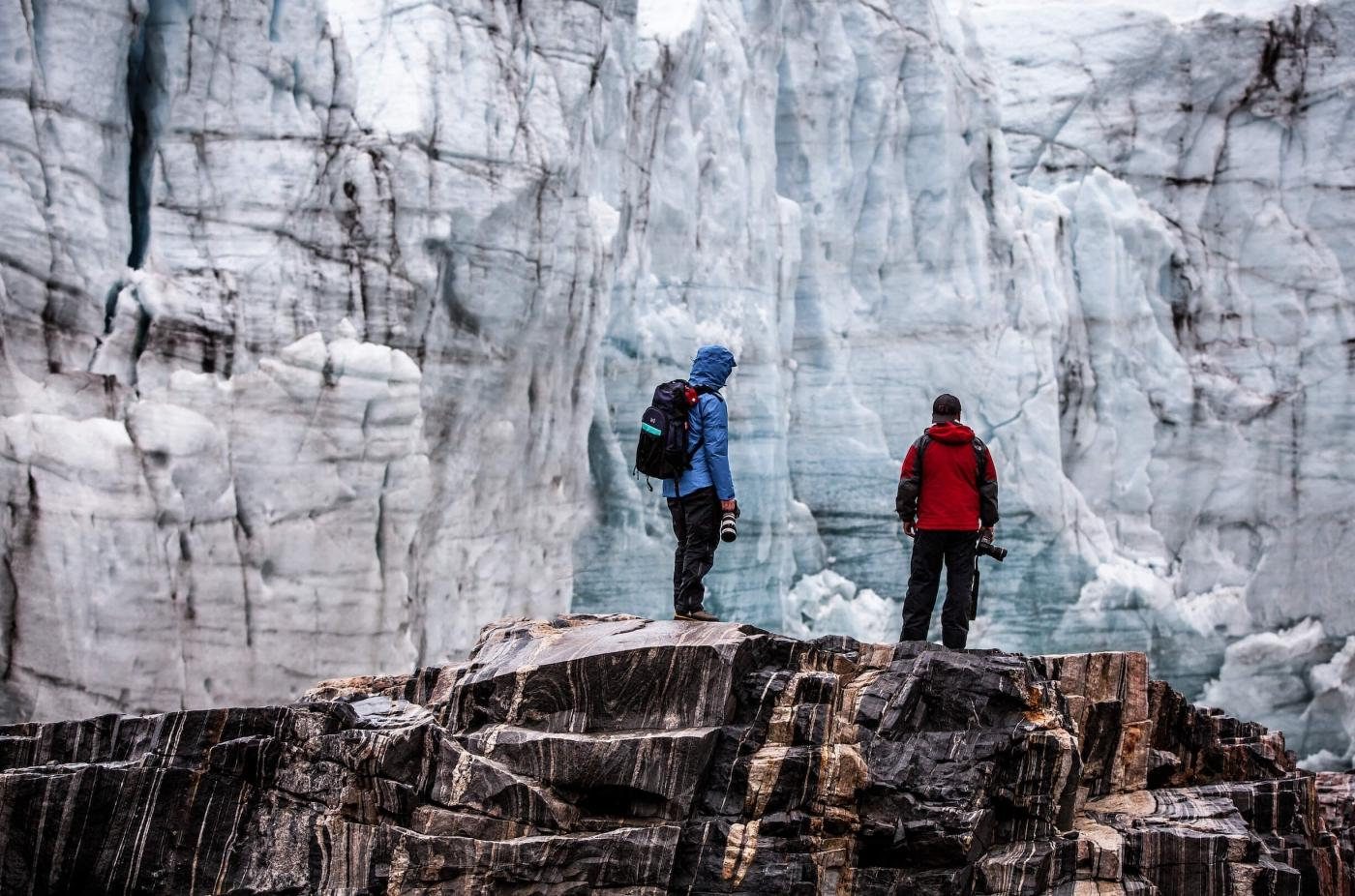 Two photographers on a photo tour by the Russell Glacier in Greenland. Photo by Mads Pihl