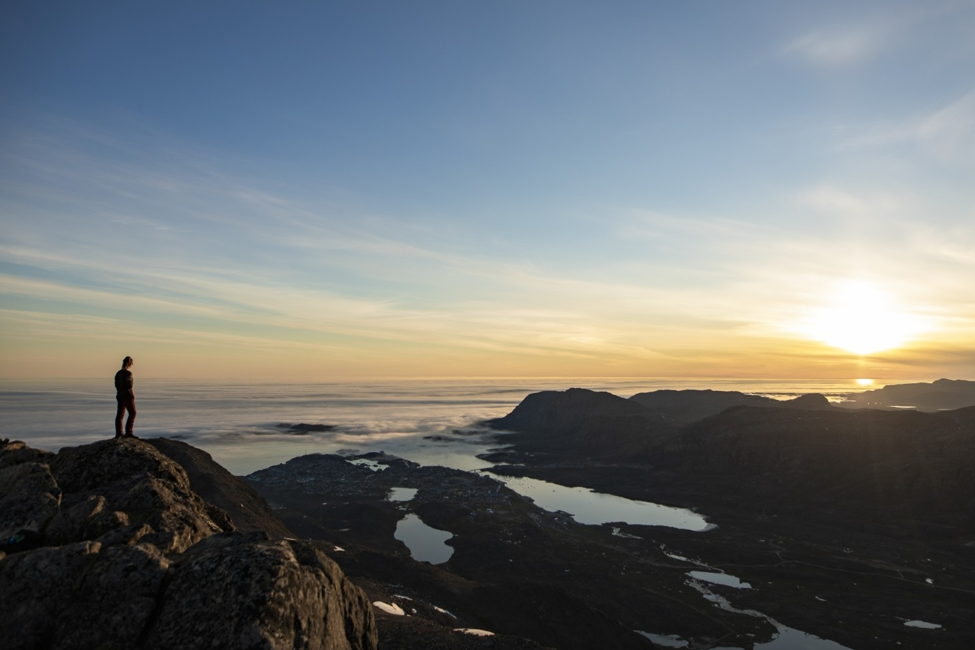 Stand above the clouds at mountain Nasaasaaq. Photo by Aningaaq R Carlsen - Visit Greenland