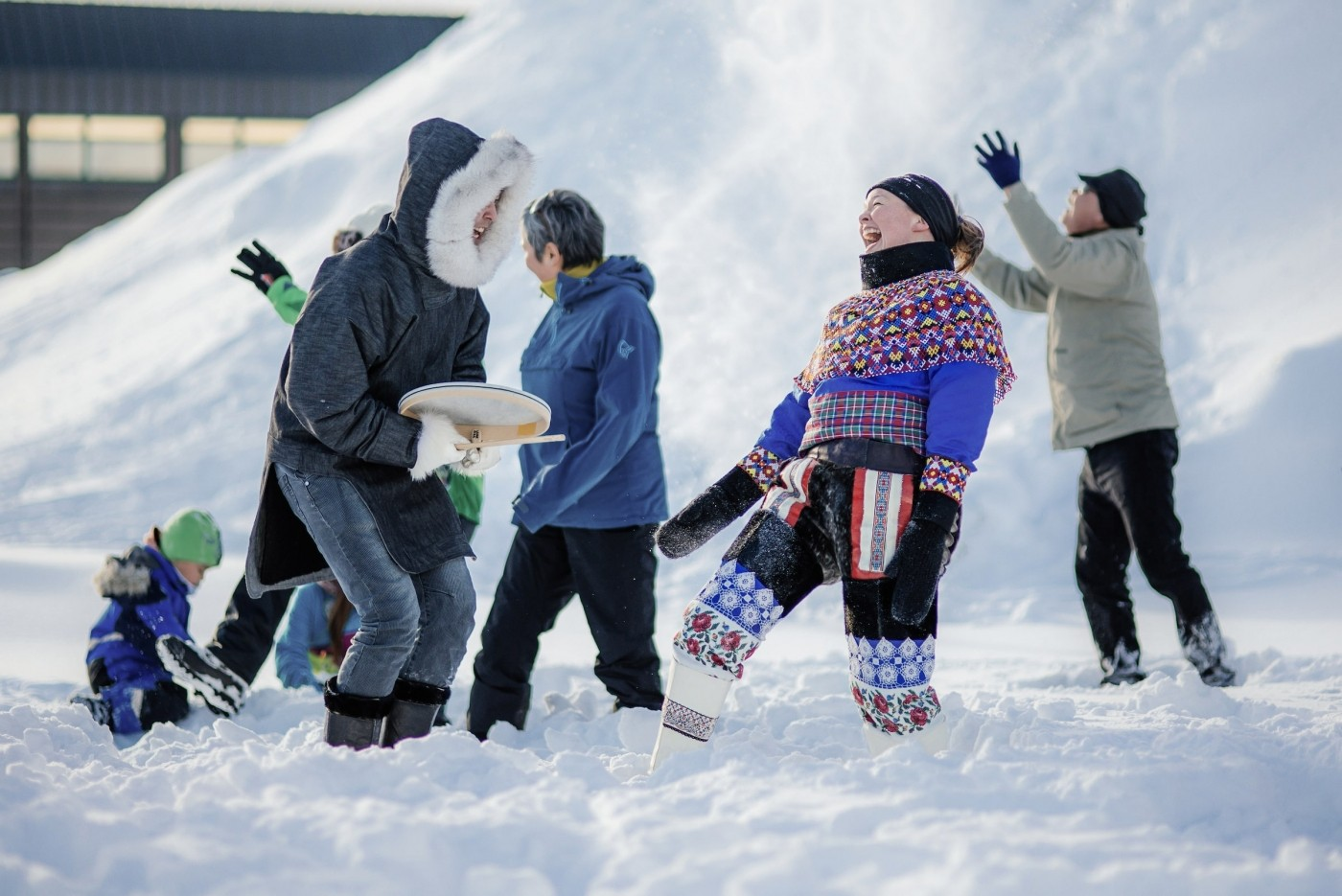Two people laughing and dancing in Nuuk during a _Happy_ video shoot in Greenland. Photo by Filip Gielda - Visit Greenland