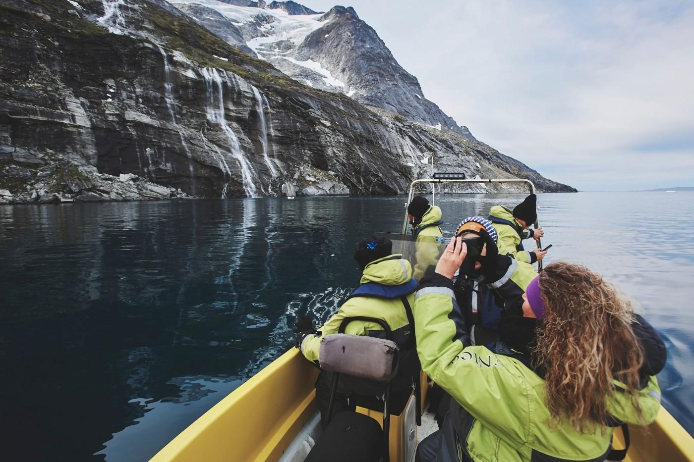 Nuuk Water Taxi stopping at a waterfall. Photo by: Aningaaq Rosing Carlsen - Visit Greenland