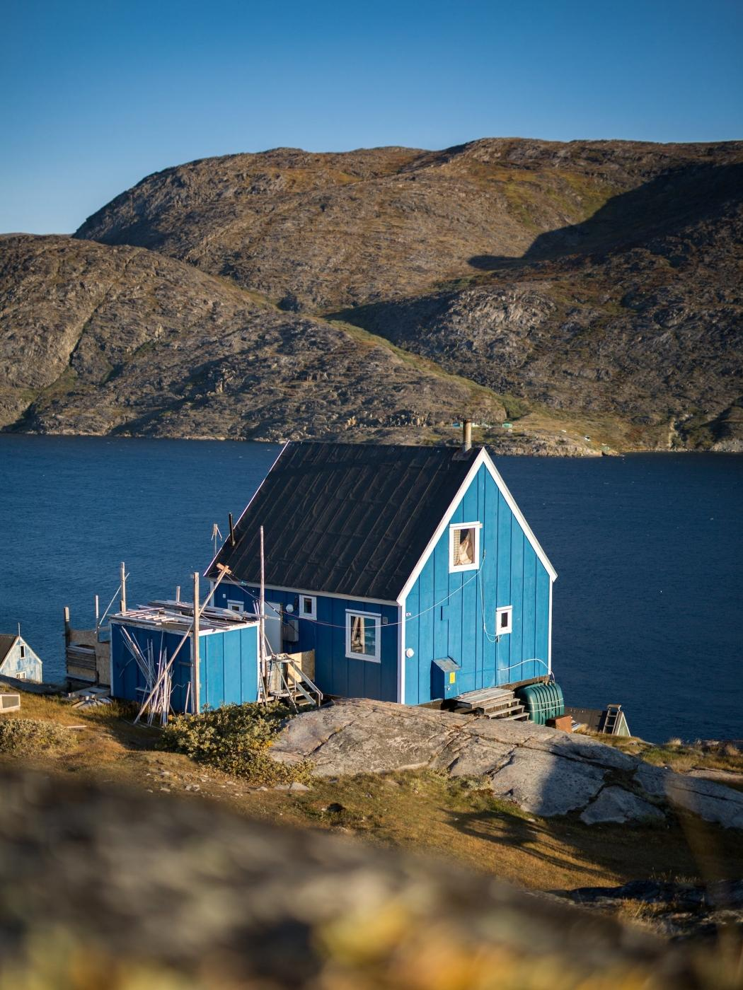 A blue house in Sarfannguit. Photo by Aningaaq R Carlsen - Visit Greenland