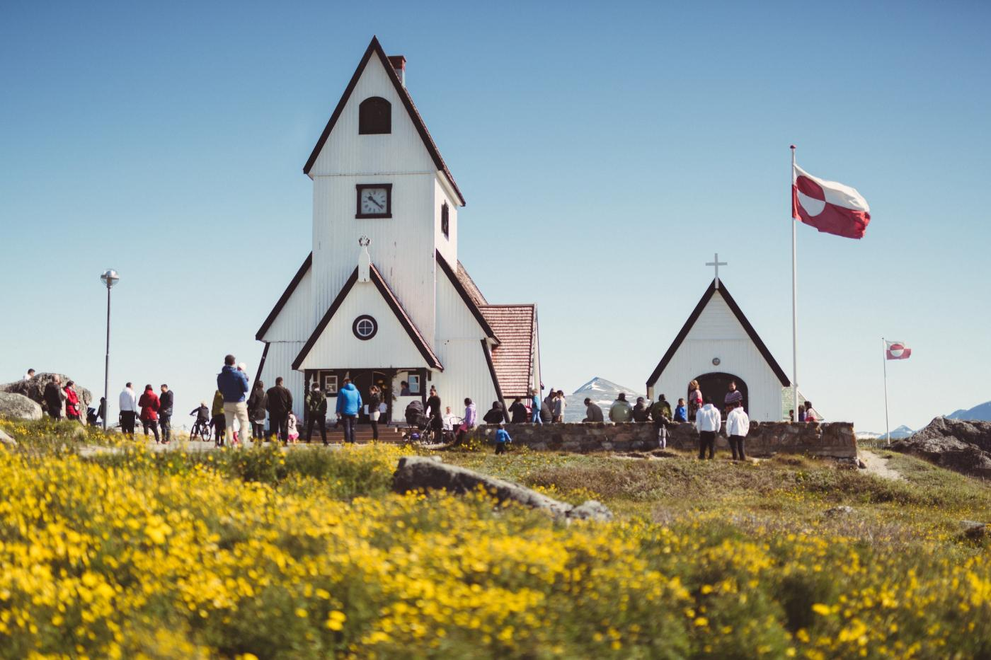 A sunny day at the Nanortalik church in South Greenland. Photo by Mads Pihl - Visit Greenland