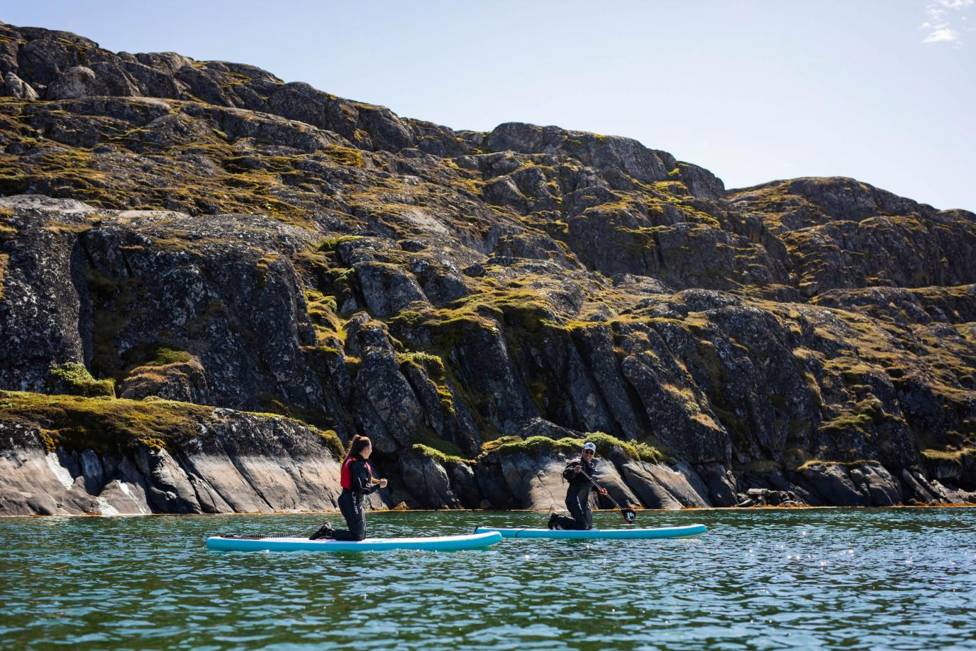SUPs with rocky surroundings near Sisimiut. Photo - Aningaaq R. Carlsen, Visit Greenland