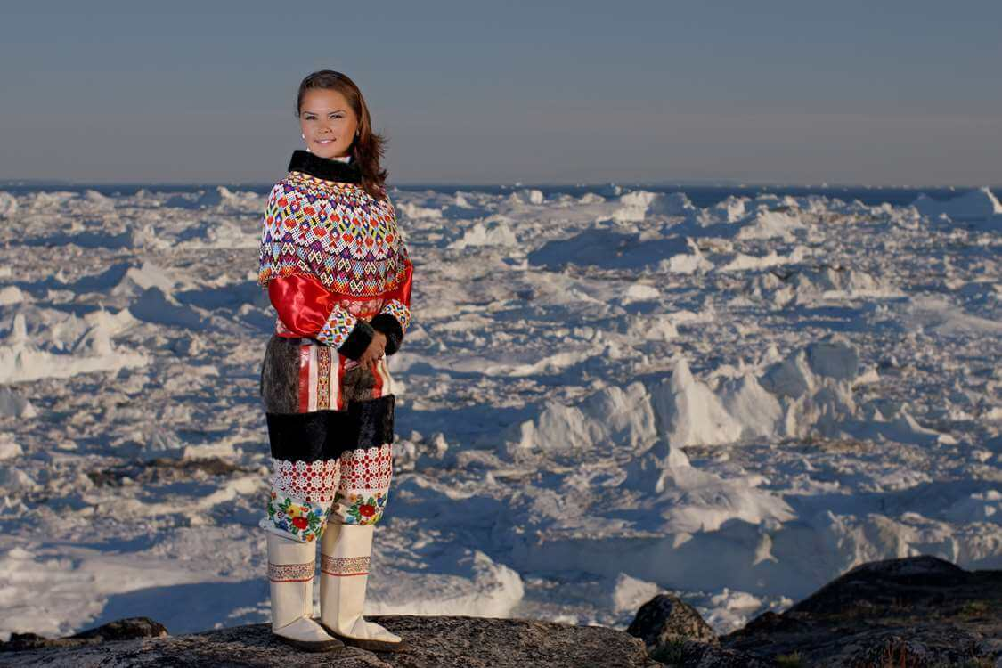 Woman in traditional Inuit Clothing. Photo by Thomas Eltorp, Visit Greenland